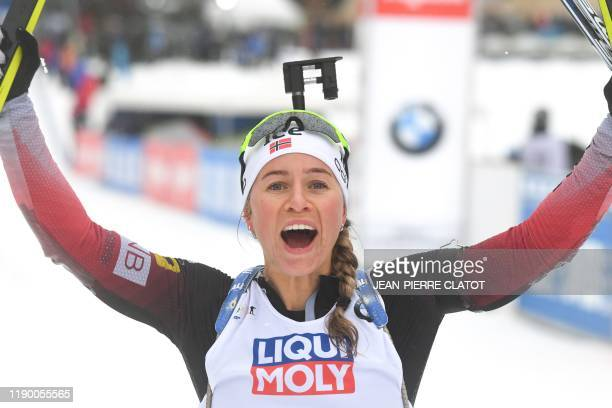 First-placed Norway's Tiril Eckhoff celebrates after crossing the finish line and winning the Women's 12,5 km mass start during the IBU World Cup...