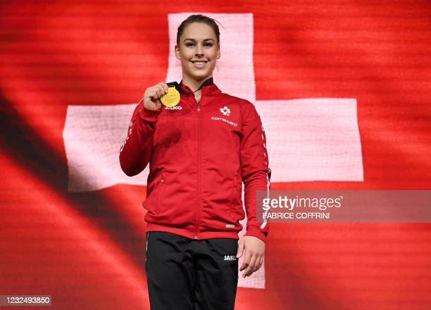 First-placed Switzerland's Giulia Steingruber celebrates on the podium with her gold medal during the award ceremony after competing in the Women's...