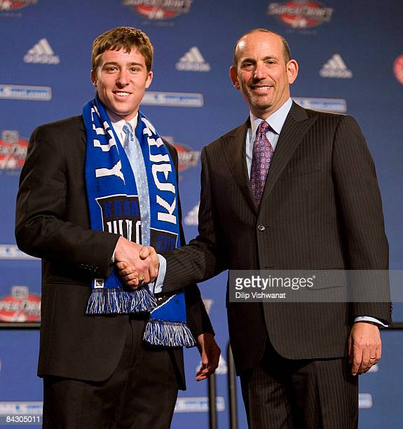 Firstround draft pick Matt Besler of the Kansas City Wizards is congratulated by Major League Soccer commissioner Don Garber during the MLS 2009...