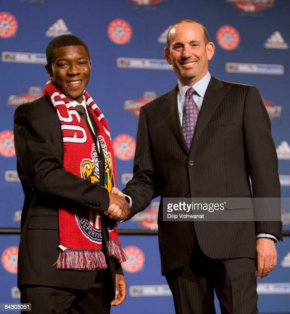 Firstround draft pick Michael Lahoud of Chivas USA is congratulated by Major League Soccer commissioner Don Garber during the MLS 2009 Super Draft at...