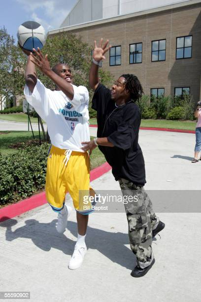 Firstround pick Chris Paul of the New Orleans Hornets plays basketball with New Orleans evacuees at Bethany Baptist Church on September 15 2005 in...