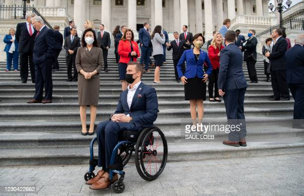 First-term Republican members of Congress await group photographs on the steps of the US Capitol in Washington, DC, January 4, 2021. - Donald Trump...