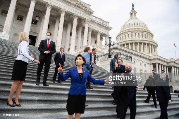 First-term Republican members of Congress stand together for photographs on the steps of the US Capitol in Washington, DC, January 4, 2021. - Donald...