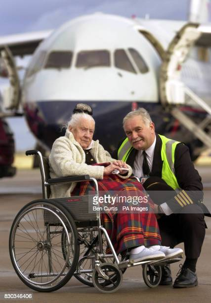 Firsttime flier Daisy Millar from Forres NorthEast Scotland is welcomed by Captain Winston Oliver at Inverness Airport as she celebrates her 103rd...