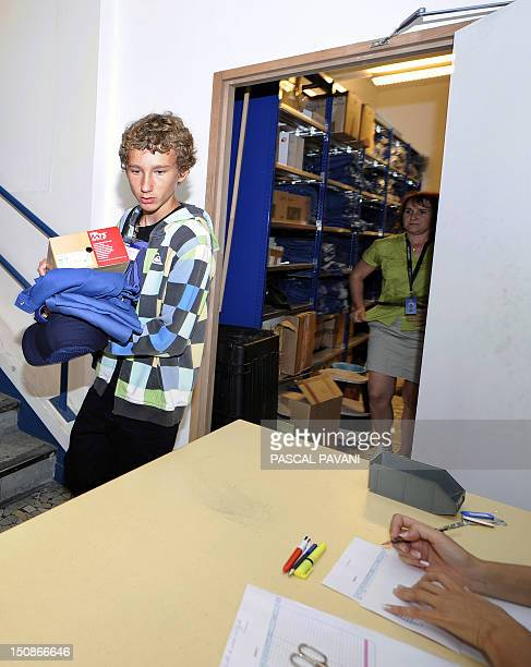 A firstyear student of the Airbus Private Vocational School for Aeronautics Professions gets his safety equipment on August 28 2012 at the Airbus...