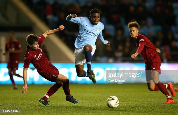 Fisayo Dele-Bashiru of Manchester City beats Neco Williams of Liverpool during the FA Youth Cup Final between Manchester City and Liverpool at...