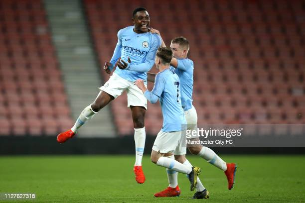 Fisayo DeleBashiru of Manchester City celebrates after scoring his team's third goal with team mates during the FA Youth Cup 6th Round match between...