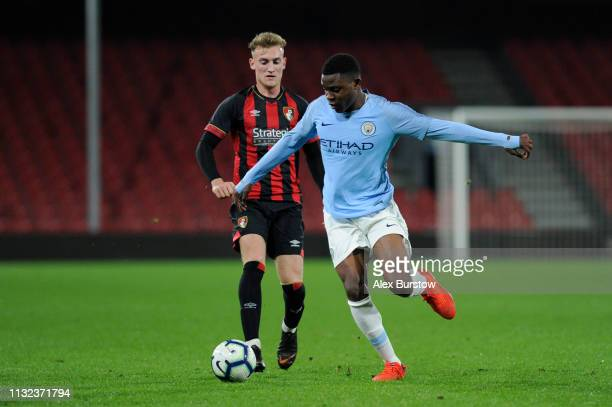 Fisayo DeleBashiru of Manchester City runs with the ball under pressure from Jake Cope of AFC Bournemouth during the FA Youth Cup Sixth Round Match...