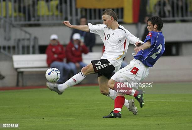 Fischer Manuel of Germany evades Brkovic Dusan of Serbia Montenegro to score the second goal, during the Men's Under 17 European Championship match...