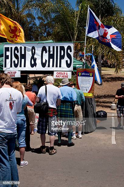 fish & chips vendor - kilt stock photos and pictures
