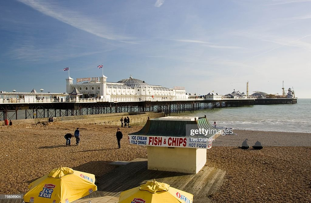 Fish and chip shop on beach by Brighton Pier, England