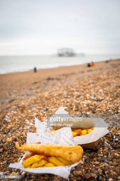 fish and chips on the beach - overcast stock pictures, royalty-free photos & images