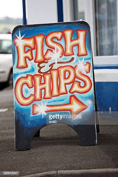 Fish and chips sign at typical UK seaside resort