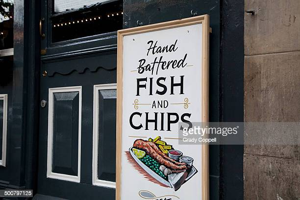 Fish and chips sign outside pub