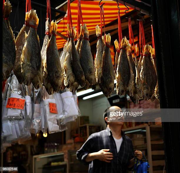 Fish are hung up to dry in a dried food seafood market in Hong Kong's Shueng Wan district on March 21 2010 AFP PHOTO / Dale de la Rey