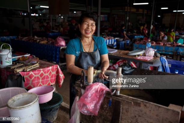 fish cleaner. - laotian culture stock pictures, royalty-free photos & images