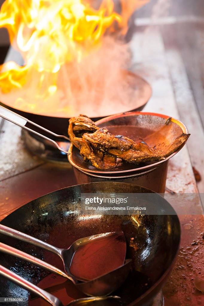 Fish deep-fried in asian wok on the street food stall, Penang, Malaysia : Stock Photo