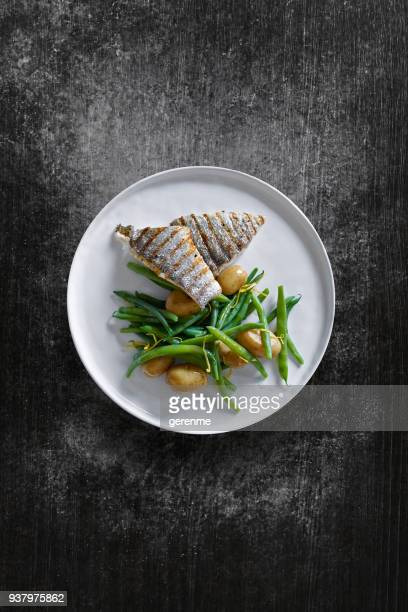 fish dish - plate stock photos and pictures