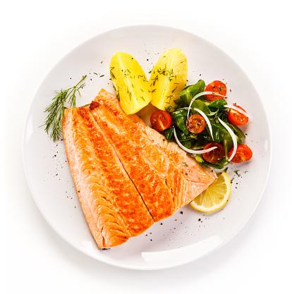 Fish dish - salmon steak and vegetables 898087604