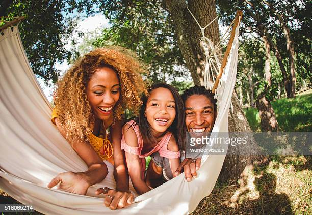 Fish eye lens shot of African-American family relaxing