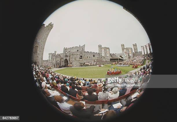 Fish eye lens view of guests and dignitaries attending the Investiture of Prince Charles Prince of Wales at Caernarfon Castle in Wales on 1st July...
