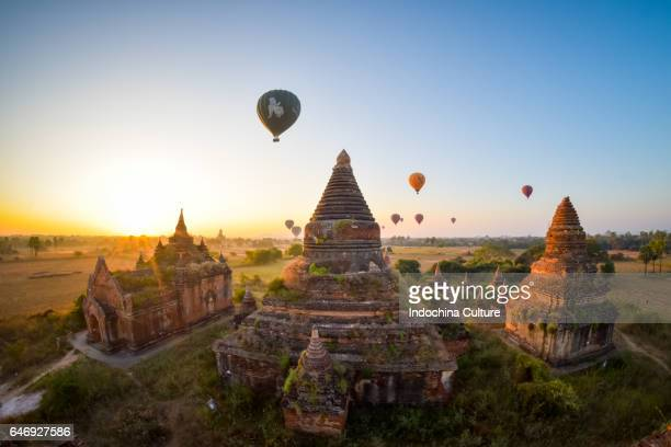 fish eye view of hot air ballons over acient temples in the beautiful morning, old bagan, burma, myanmar - myanmar stock pictures, royalty-free photos & images