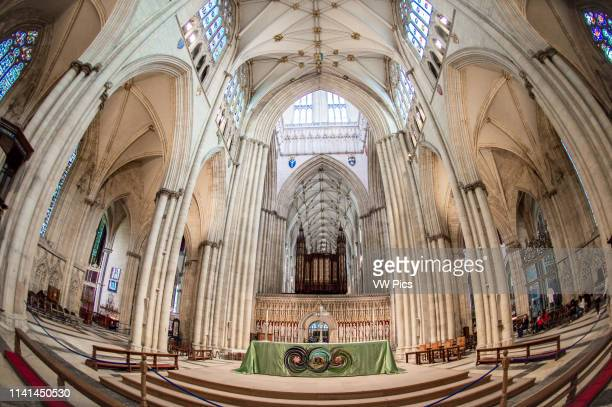 Fish eye view of the interior York Minster with alter and pipe organ in the center York Yorkshire United Kingdom