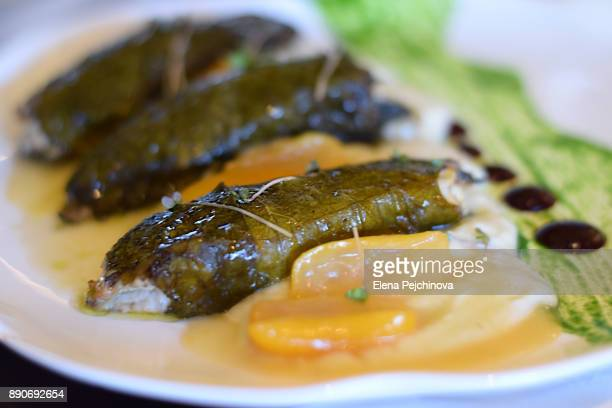 Fish in vine leaves