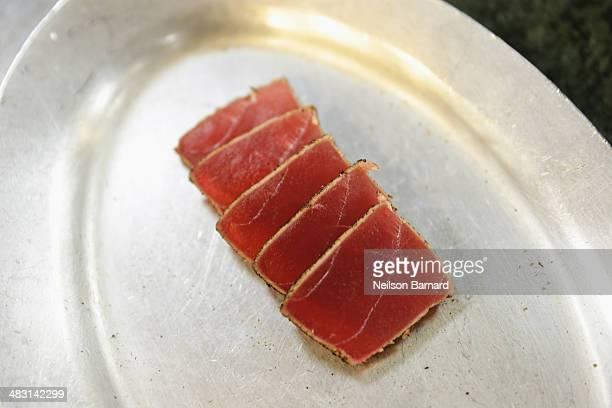 Fish is seen on a plate as Chef Shaun Hergatt of Juni prepares Yellow Fin Tuna Hijiki Seaweed and Cucumber Gelee Flounder Saffron Esupma Kingfish...