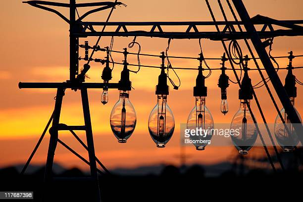 Fish lamps are silhouetted against a sunset at a fishing port in Oma Town Aomori Prefecture Japan on Saturday June 25 2011 Over the 29 years since...