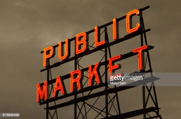 fish market, seattle, wa - neon letters stock photos and pictures