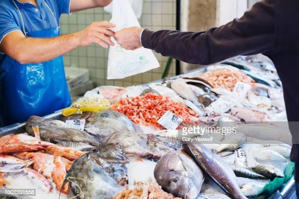 Fish market transaction in Venice