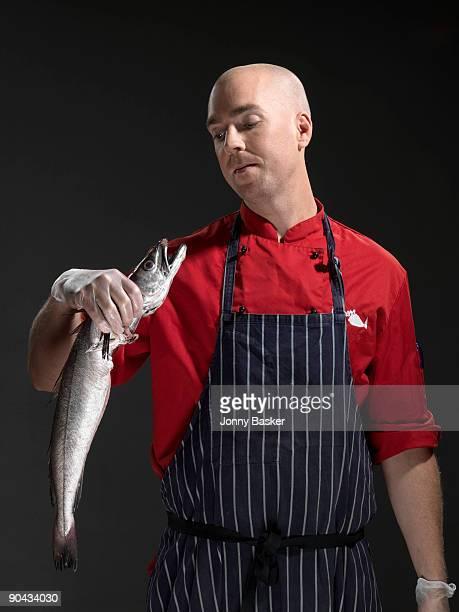 Fish mongler holding fish