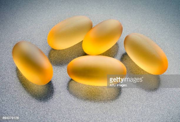 fish oil pills - omega 3 stock pictures, royalty-free photos & images