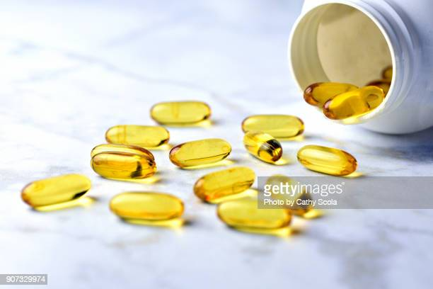 fish oil pills - nutritional supplement stock pictures, royalty-free photos & images