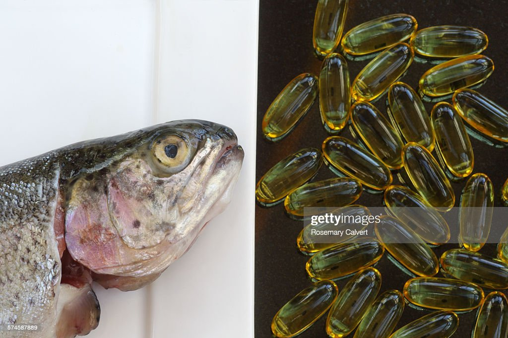 Fish oils from oily fish or capsules : Stock Photo