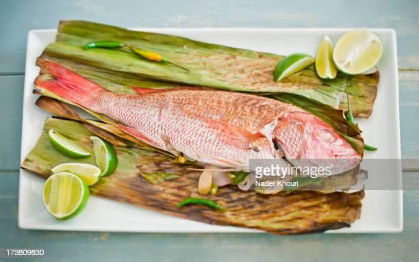 Fish on lime and corn husk