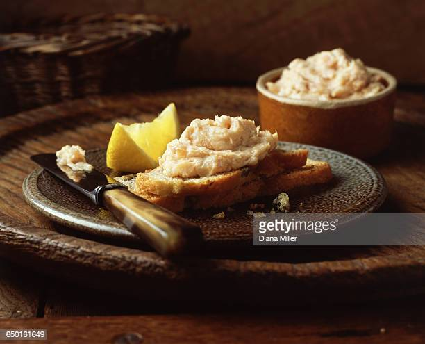 fish pate on sliced bread with lemon slice - pate stock photos and pictures