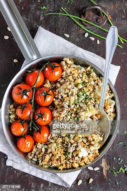 Fish pie or crumble with mixed seeds and roasted cherry tomatoes