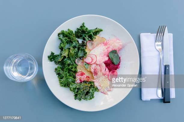 fish served with potato, radish and kale, directly above view - 西洋わさび ストックフォトと画像