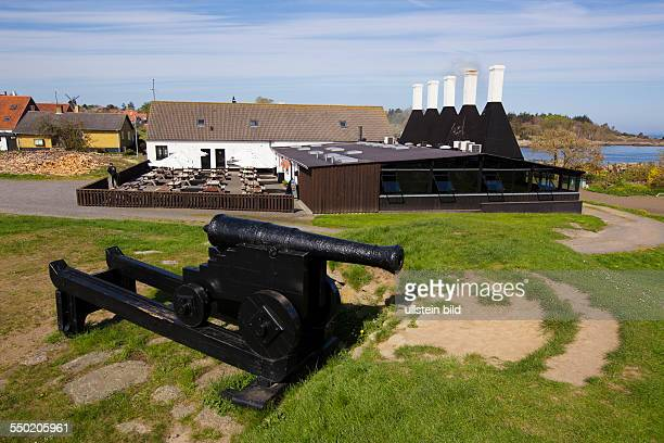 Fish smoke house and restaurant with historic cannon on Bornholm