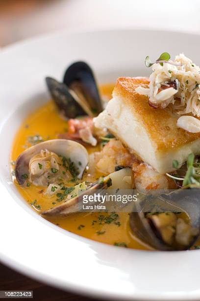 A fish stew with clams, mussels, shrimp in tomato sauce