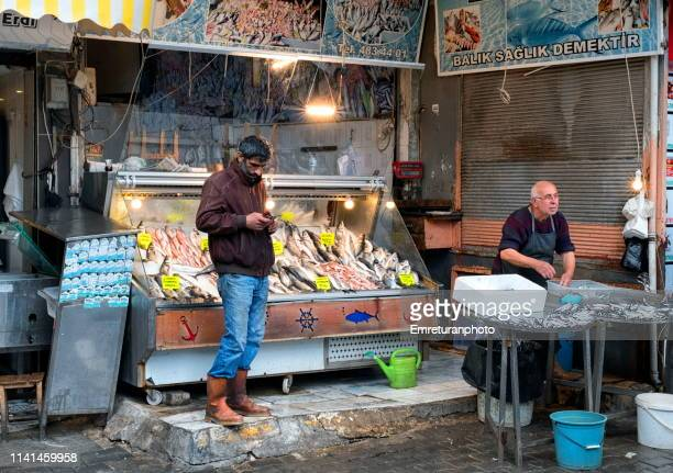 fish vendor at shopping district kemeralti. - emreturanphoto stock pictures, royalty-free photos & images