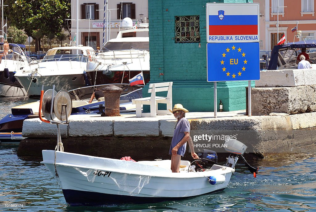 A fisheman enters the harbour of the Slovenian Adriatic coastal town of Piran near the Croatian border, some 120 kilometers from capital Ljubaljana, on June 6, 2010. Slovenians went to the polls today in a referendum on a deal with Croatia to allow an arbitration panel to settle a long-running border dispute. Ljubljana and Zagreb have been in disaccord for 19 years -- since the breakup of Yugoslavia -- over 13 square kilometres (five square miles) of largely uninhabited land and a wedge of territorial water in and around Piran Bay.