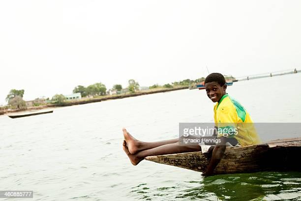 CONTENT] Fisher boy riding a wooden canoe in Shimoni / Wasini Kenya