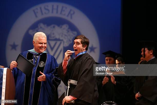 Fisher College President Dr Thomas M McGovern left with Boston Marathon Bombing victim Jeff Bauman at Fisher College 110th Commencement Bauman had...