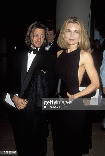 Fisher Stevens and Michelle Pfeiffer during 49th Annual Golden Globe Awards at Beverly Hilton Hotel in Beverly Hills California United States