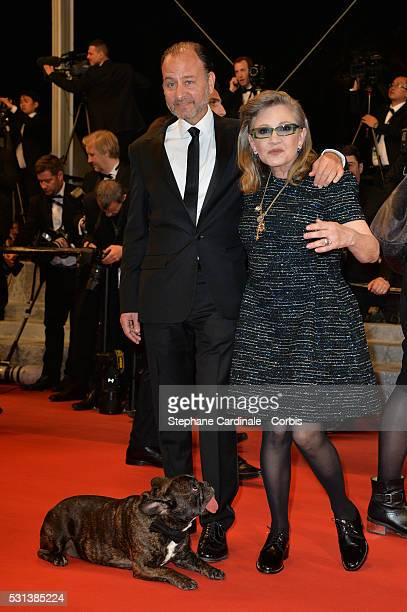 Fisher Stevens Carrie Fisher and Gary the dog attend 'The Handmaiden ' premiere during the 69th annual Cannes Film Festival at the Palais des...