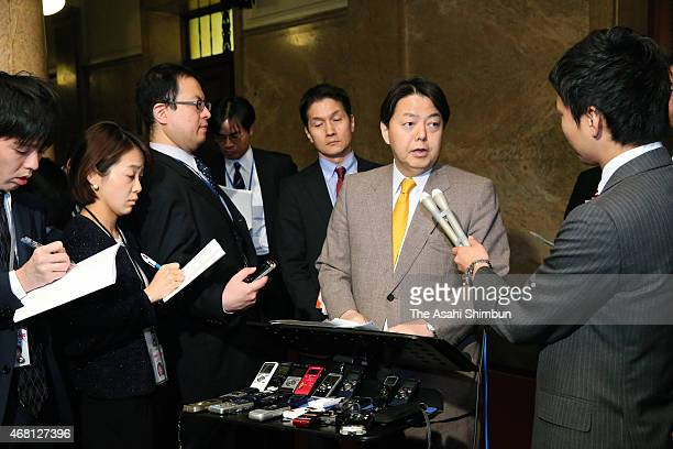 Fisheries minister Yoshimasa Hayashi speaks to media reporters at the diet building on March 30 2015 in Tokyo Japan Fisheries minister Yoshimasa...