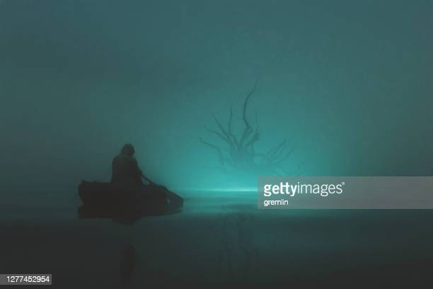 fisherman against fantasy monster - tentacle stock pictures, royalty-free photos & images